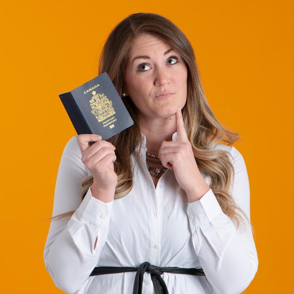 Amanda Olfati Holding Passport and thinking of where she will travel next