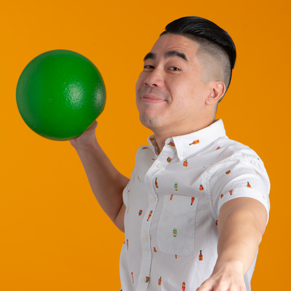 Christopher Woo throwing a green dodgeball to the camera