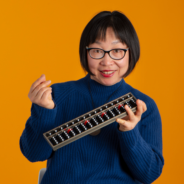Ling Li holding an abacus