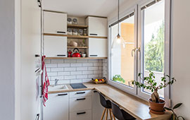 small kitchen with white cupboards