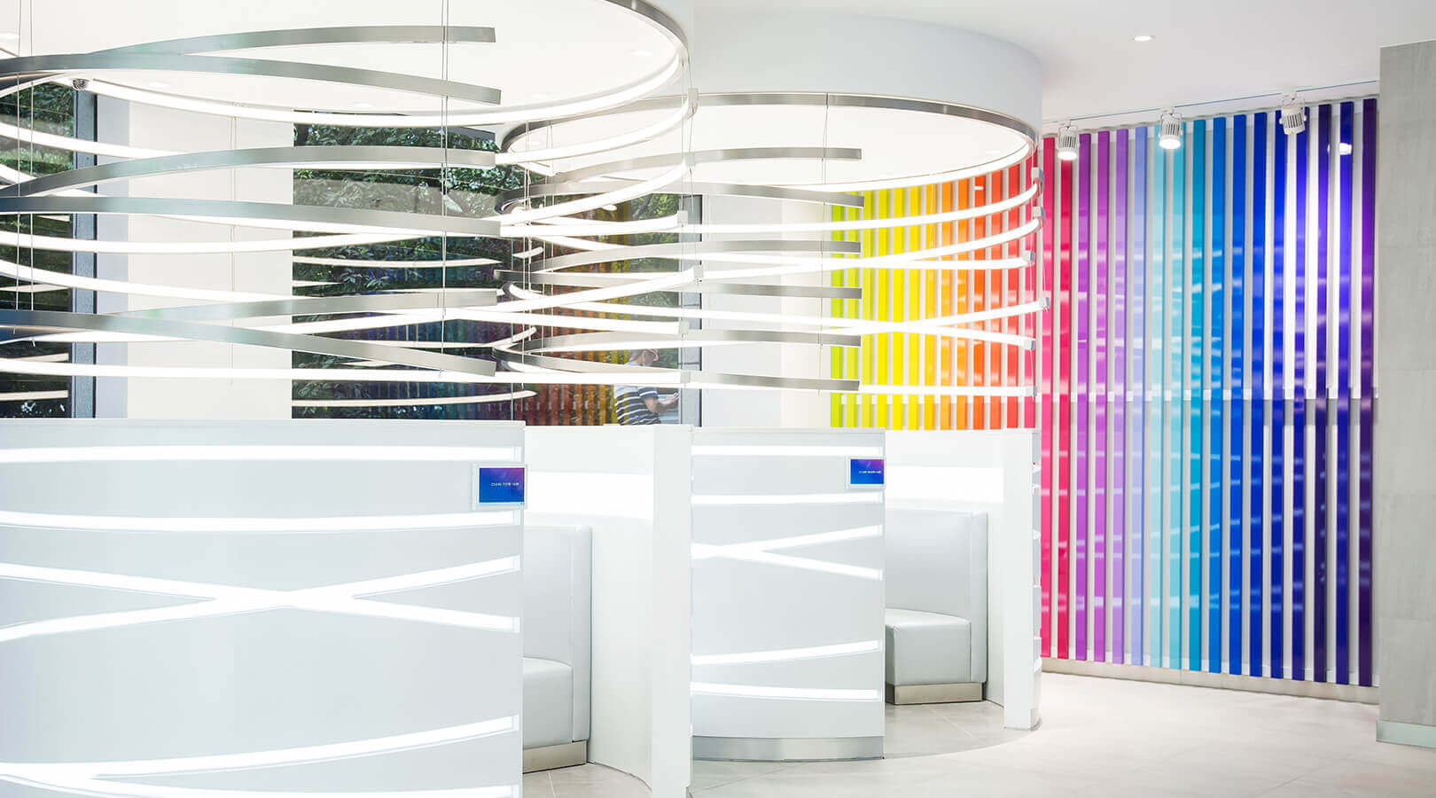 nu skin interior of store with sitting pods and colourful wall