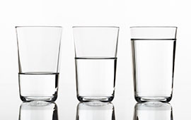 Photo of glasses that are half full and half empty