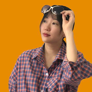 Monica Li Headshot Orange Background