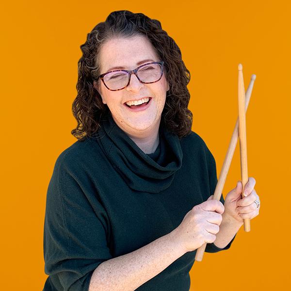 Ellen Evered holding drumsticks